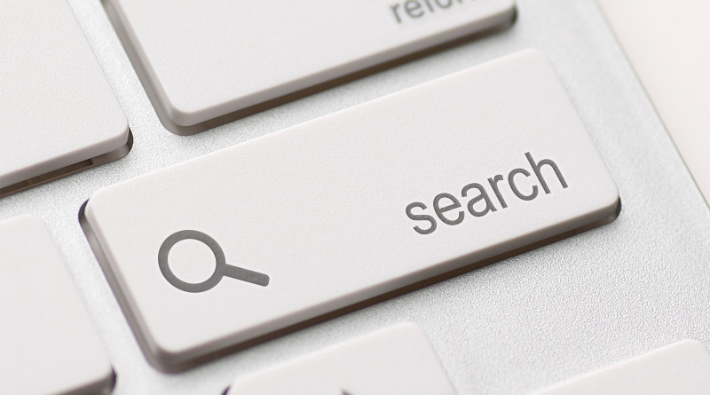 search enter button key on white keyboard